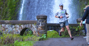 Runner at waterfall